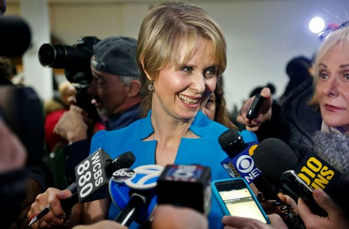 Candidate for New York governor Cynthia Nixon speaks with reporters at her first campaign stop, in the Brownsville section of Brooklyn, in New York. Nixon will challenge New York Gov. Andrew Cuomo for the Democratic nomination.
