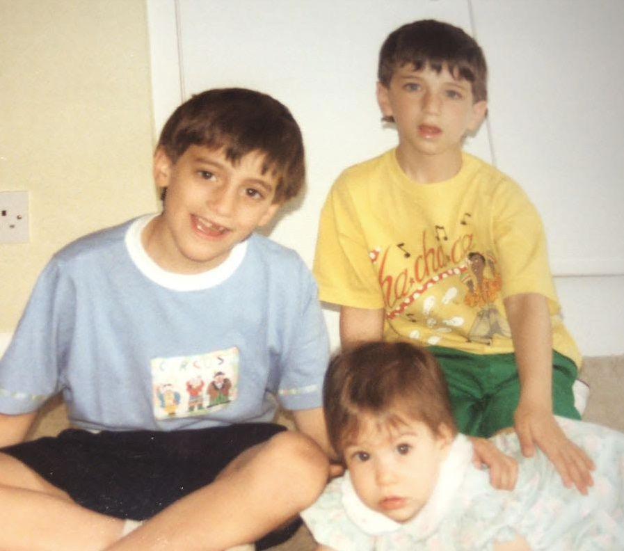 Then: Robert (L), Darren (in yellow) and their sister Emma in 1990.