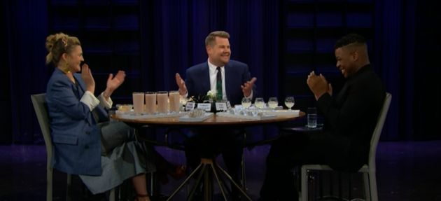 Drew and John laugh along as James reveals what he stole from Mariah's living