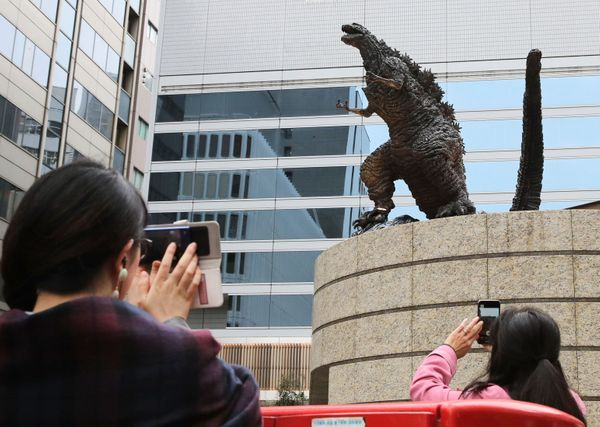 People take pictures of the new statue.