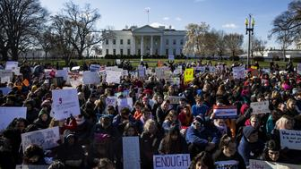 WASHINGTON, USA - MARCH 14: Thousands of students sit in silence with their backs to the White House for 17 minutes for the 17 people killed by a gunman in the shooting at Marjory Stoneman Douglas High School in Washington, United States on March 14, 2018. (Photo by Samuel Corum/Anadolu Agency/Getty Images)