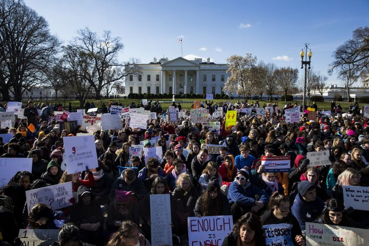 Students sit for 17 minutes in silence with their backs to the White House on March 14 in memory of the 17 people k