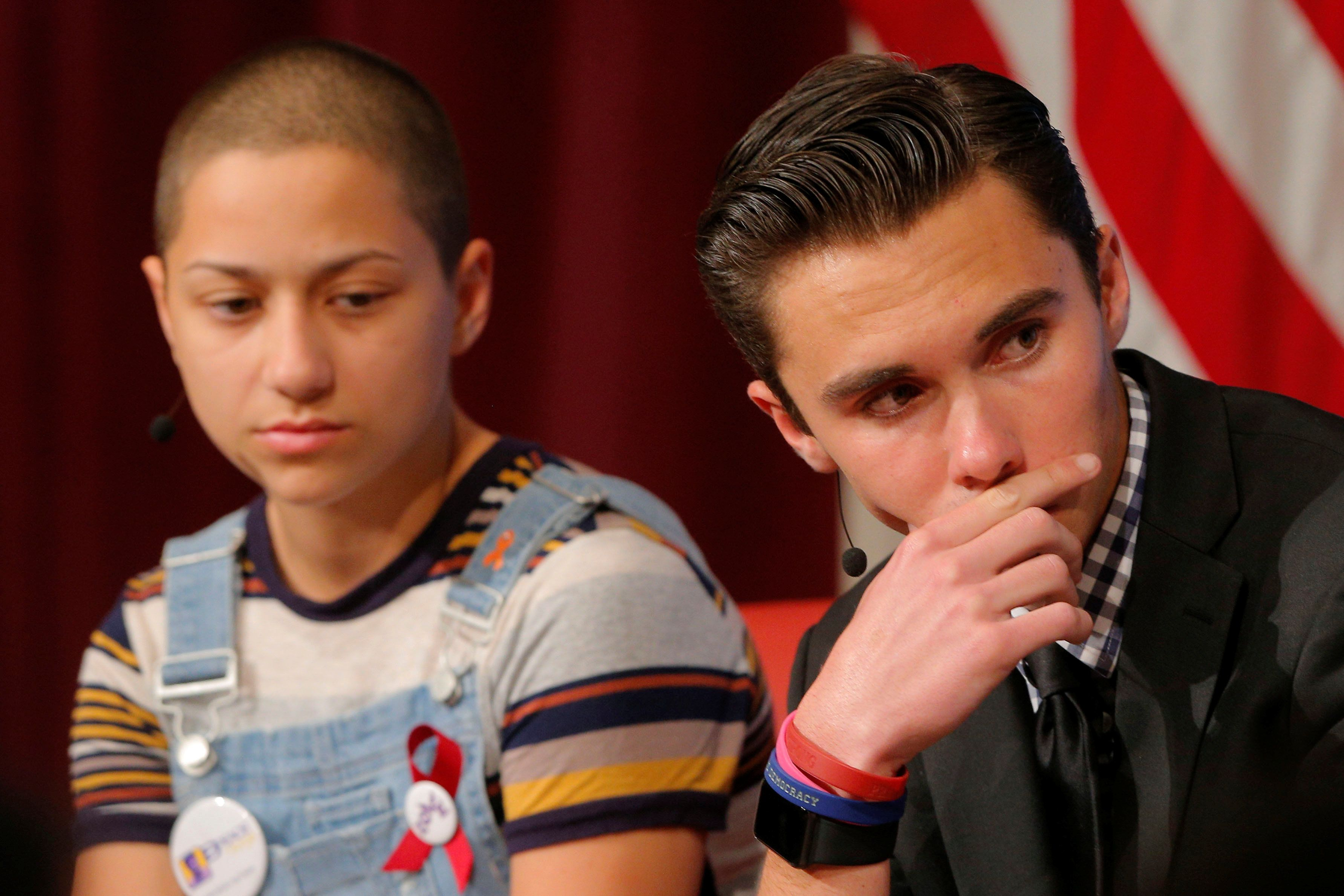 "Emma Gonzalez (L) and David Hogg, survivors of the February mass shooting at the Marjory Stoneman Douglas High School, discuss their ""#NeverAgain"" push to end school shootings at Harvard University's Kennedy School of Government in Cambridge, Massachusetts, U.S., March 20, 2018.   REUTERS/Brian Snyder"