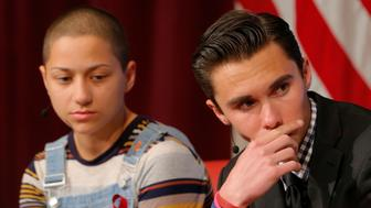 """Emma Gonzalez (L) and David Hogg, survivors of the February mass shooting at the Marjory Stoneman Douglas High School, discuss their """"#NeverAgain"""" push to end school shootings at Harvard University's Kennedy School of Government in Cambridge, Massachusetts, U.S., March 20, 2018.   REUTERS/Brian Snyder"""