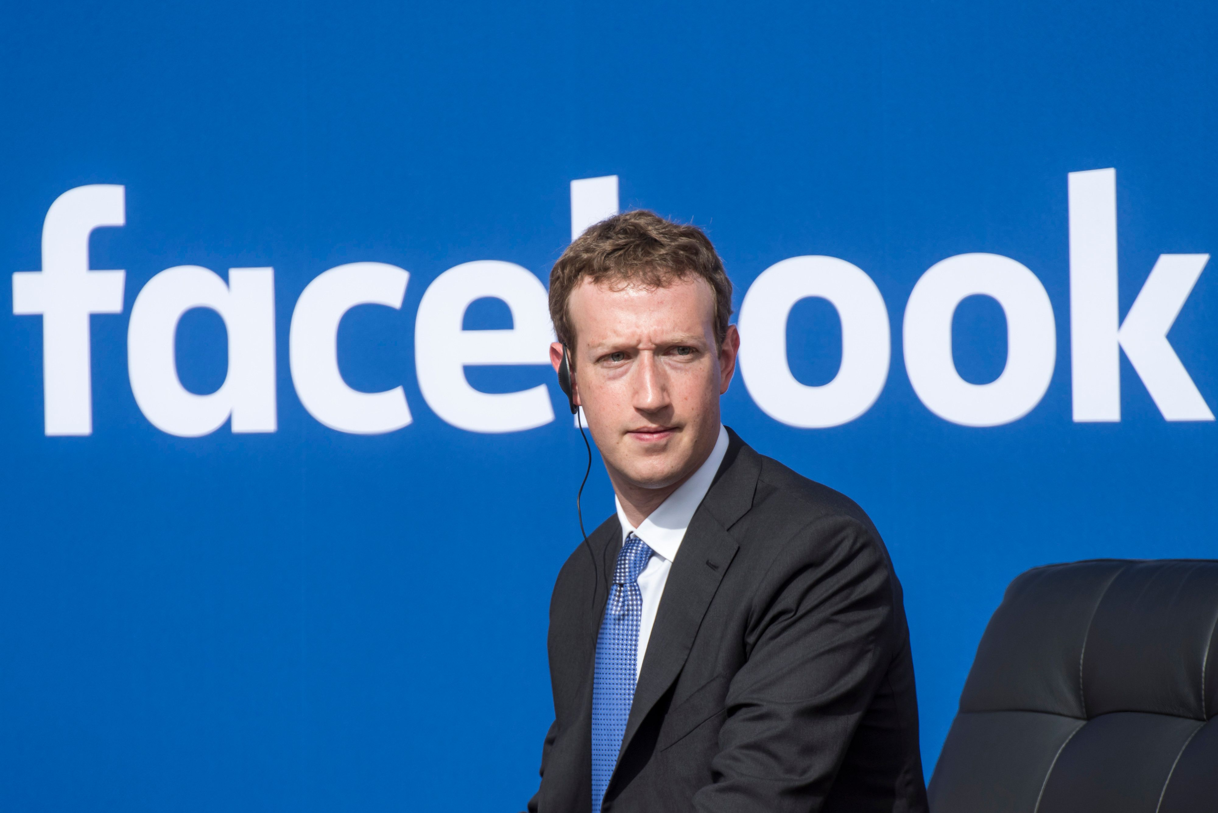 Mark Zuckerberg, chief executive officer of Facebook Inc., listens as Narendra Modi, India's prime minister, not pictured, speaks during a town hall meeting at Facebook headquarters in Menlo Park, California, U.S., on Sunday, Sept. 27, 2015. Prime Minister Modi plans on connecting 600,000 villages across India using fiber optic cable as part of his 'dream' to expand the world's largest democracy's economy to $20 trillion. Photographer: David Paul Morris/Bloomberg via Getty Images