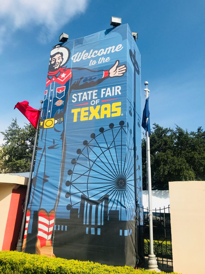 A sign featuring Big Tex greets visitors to Fair Park in Dallas. <i>South</i> Dallas.