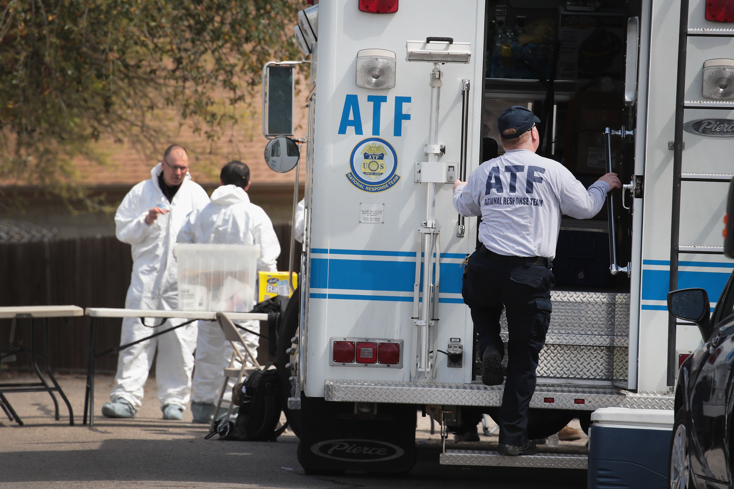 PFLUGERVILLE, TX - MARCH 22:  Law enforcement officials continue their investigation at the home of Mark Anthony Conditt March 22, 2018 in Pflugerville, Texas. Conditt, the 23-year-old suspect in the Austin package bombings, blew himself up inside his SUV as police tried to take him into custody yesterday in the nearby city of Round Rock. A massive search for the bomber had been underway by local and federal law enforcement officials in Austin and the surrounding area after several package bombs had detonated in recent weeks, killing two people and injuring several others.  (Photo by Scott Olson/Getty Images)