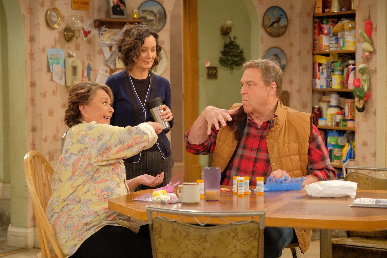 "Roseanne Barr, Sara Gilbert and John Goodman on ""Roseanne."""