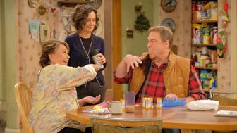 """ROSEANNE - """"Twenty Years to Life"""" - Roseanne and Dan adjust to living under the same roof with Darlene and her two children, Harris and Mark, when Darlene loses her job. Meanwhile, Becky announces she is going to be a surrogate to make extra money; and Roseanne and Jackie are at odds with one another, on the season premiere and first episode of the revival of """"Roseanne,"""" TUESDAY, MARCH 27 (8:00-8:30 p.m. EDT), on The ABC Television Network. (ABC/Adam Rose)ROSEANNE BARR, SARA GILBERT, JOHN GOODMAN"""