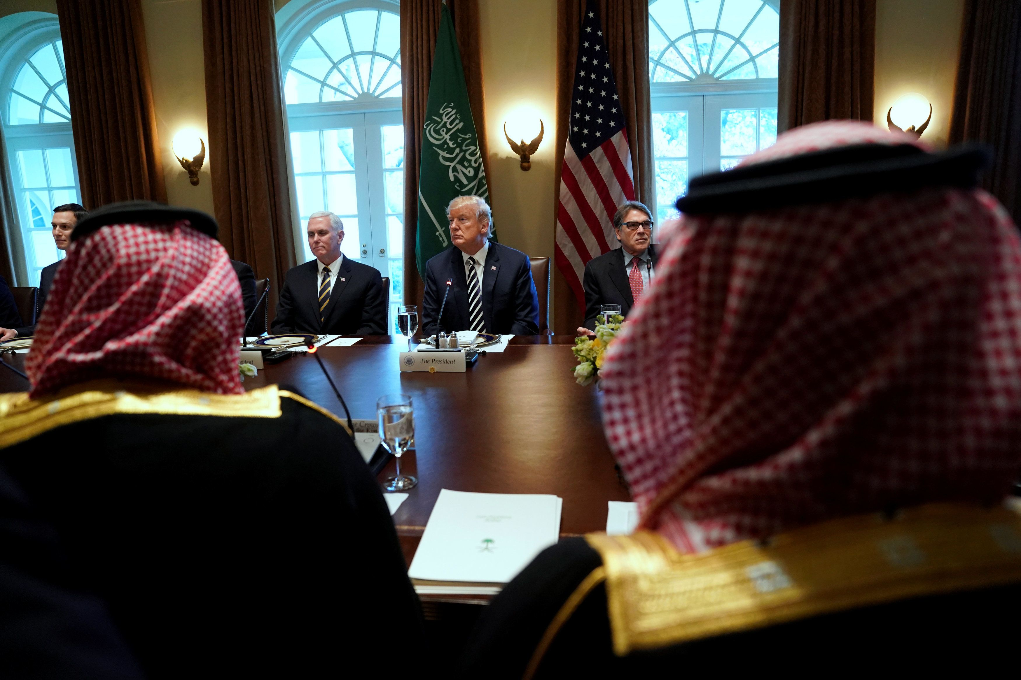 U.S. President Donald Trump, flanked by ?Vice President Mike Pence? (L) and Energy SecretaryRick Perry (R), hosts Saudi Arabia's Crown Prince Mohammed bin Salman for a working lunch at the White House in Washington, U.S. March 20, 2018.  REUTERS/Jonathan Ernst
