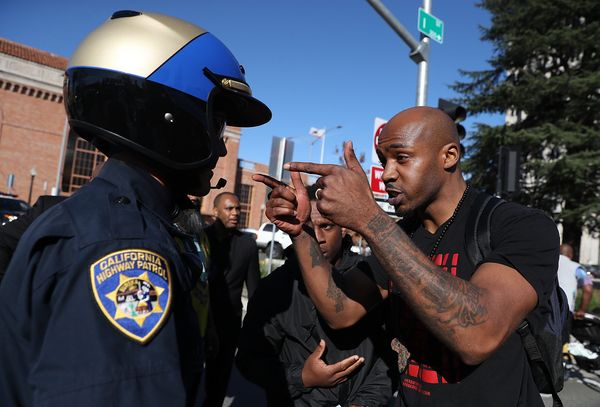 A California Highway Patrol officer is confronted by a Black Lives Matter protester during a demonstration Thursday in Sacram