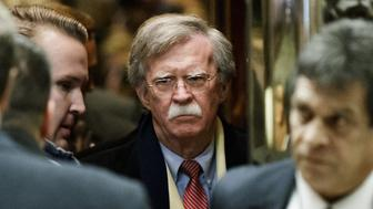 John Bolton, former U.S. ambassador to the United Nations (UN), center, stands in the elevator at Trump Tower in New York, U.S., on Friday, Dec. 2, 2016. Six years after the biggest overhaul of U.S. health care in half a century, the industry is bracing for more change under President-elect Donald Trump, who wants to tear it apart. Photographer: Justin Lane/Pool via Bloomberg