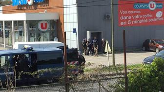 Police are seen at the scene of a hostage situation in a supermarket in Trebes, Aude, France March 23, 2018 in this picture obtained from a social media video. LA VIE A TREBES/via REUTERS ATTENTION EDITORS - THIS IMAGE WAS PROVIDED BY A THIRD PARTY. NO RESALES. NO ARCHIVES. MANDATORY CREDIT.