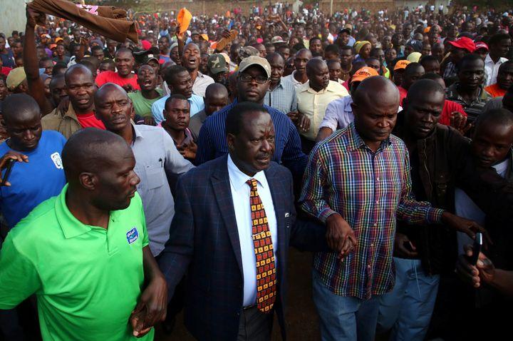 Kenyan opposition leader Raila Odinga (center) lost three successive electionsto Uhuru Kenyatta, who hadhired Cam