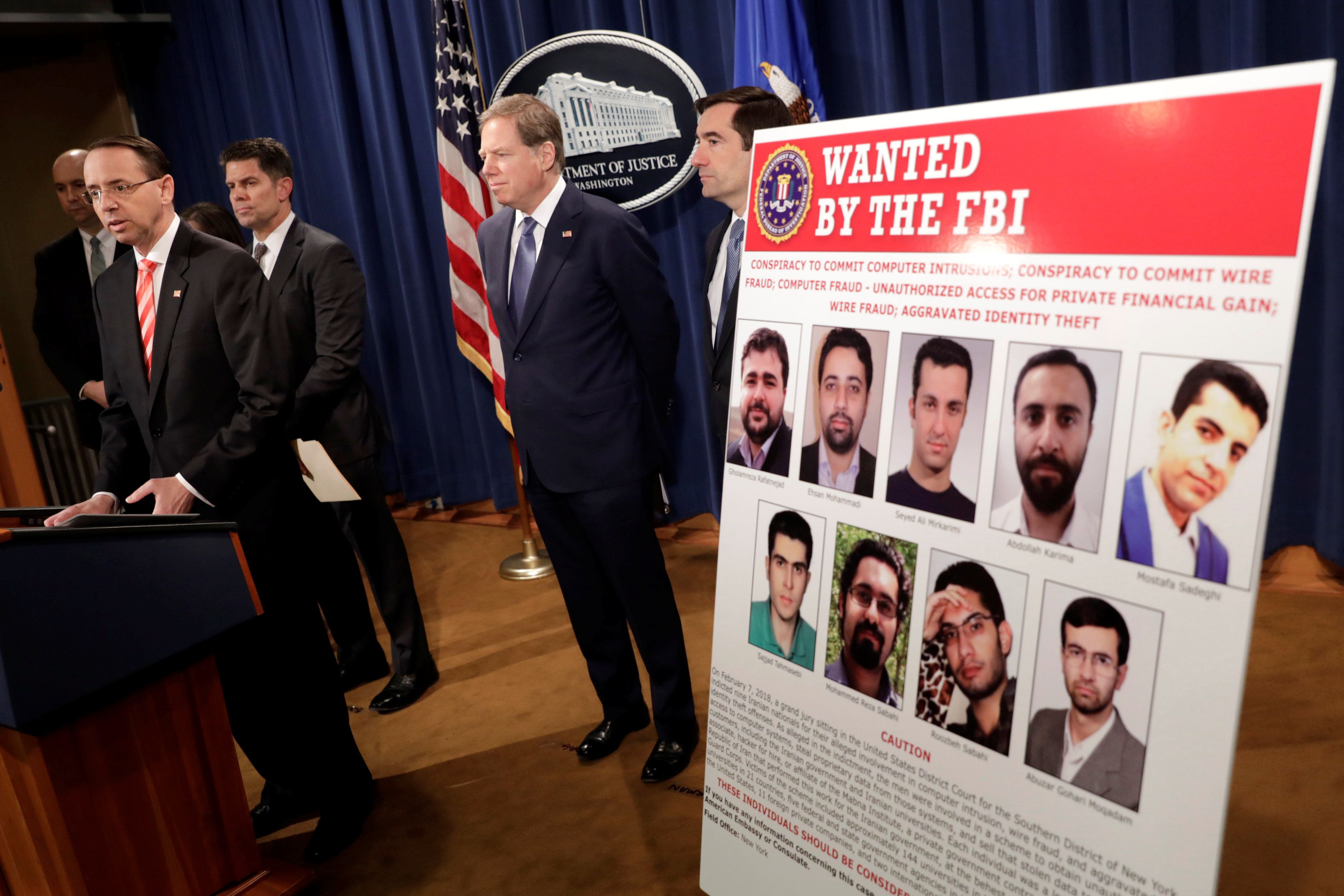 U.S. Deputy Attorney General Rod Rosenstein speaks at a news conference with other law enforcement officials at the Justice Department to announce nine Iranians charged with conducting massive cyber theft campaign, in Washington, U.S., March 23, 2018. REUTERS/Yuri Gripas