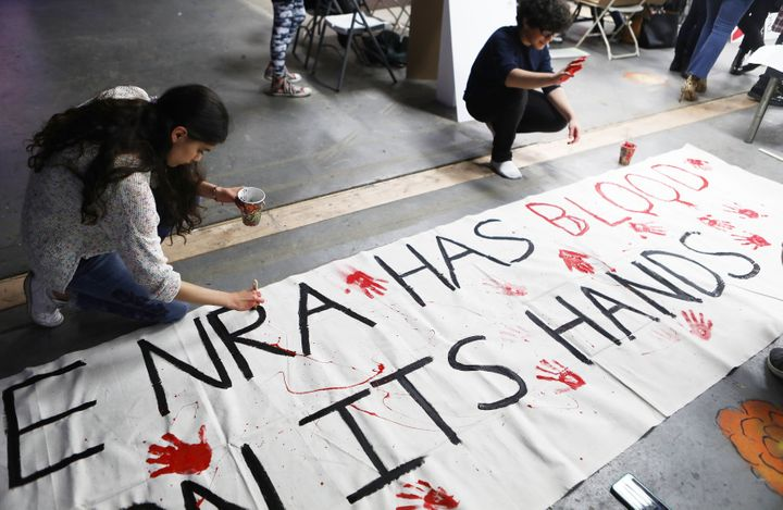Young activists paint signs to be carried at the March For Our Lives in Los Angeles.