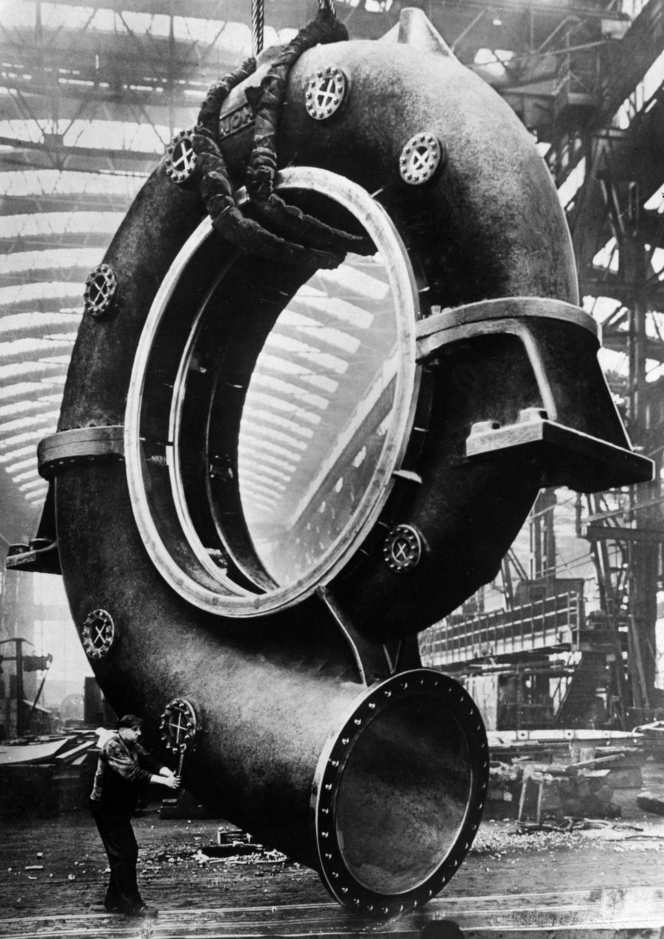 Production of a giant steel volute case for a turbine circa 1930.