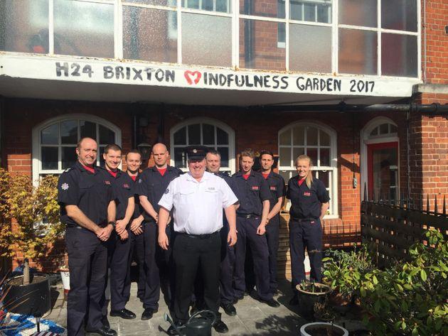 Brixton Fire Brigade's green watch withMat Rosendale (centre) andgreen champion Simon Jakeman...