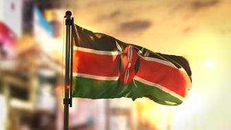 Kenya Flag Against City Blurred Background At Sunrise Backlight