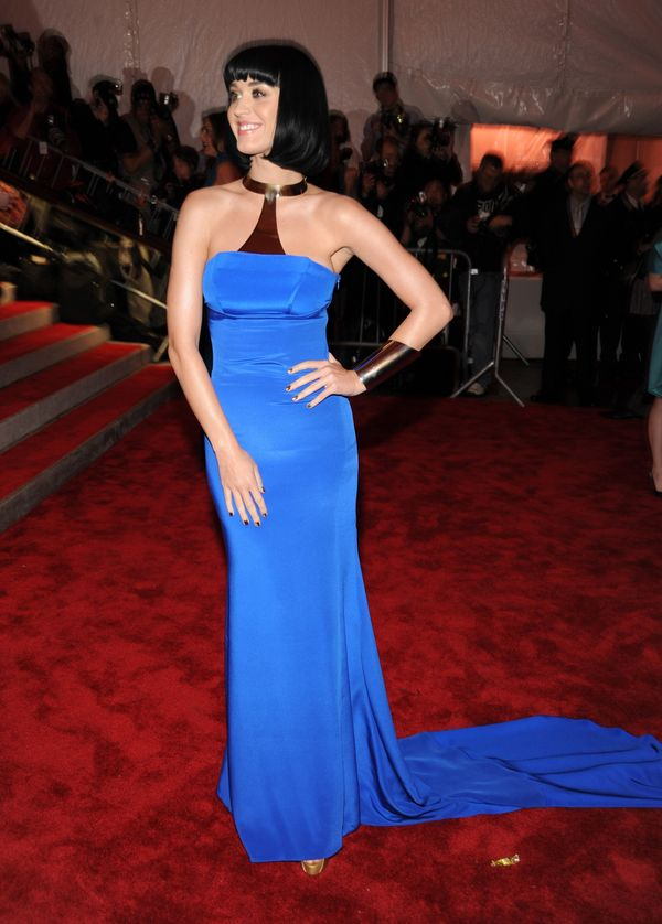 """Wearing a <a href=""""https://www.wmagazine.com/gallery/katy-perry-met-gala-dresses/all"""" target=""""_blank"""">Tommy Hilfiger </a>gown"""