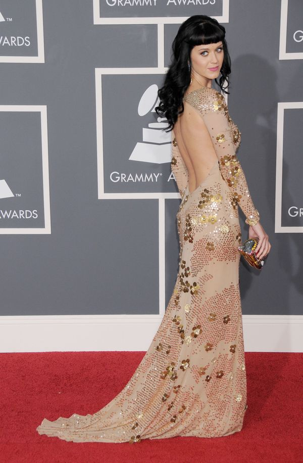 "Wearing <a href=""http://www.redcarpet-fashionawards.com/2010/02/01/runway-to-2010-grammy-awards-katy-perry-in-zac-posen/"" tar"
