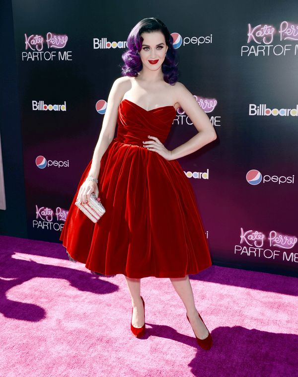 """Wearing a velvet <a href=""""http://www.redcarpet-fashionawards.com/2012/06/27/katy-perry-in-dolce-gabbana-katy-perry-part-of-me"""