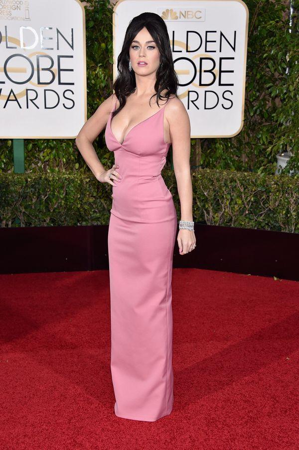 "Wearing a <a href=""https://www.hollywoodreporter.com/news/katy-perrys-golden-globes-2016-853111"" target=""_blank"">Prada</a>&nb"