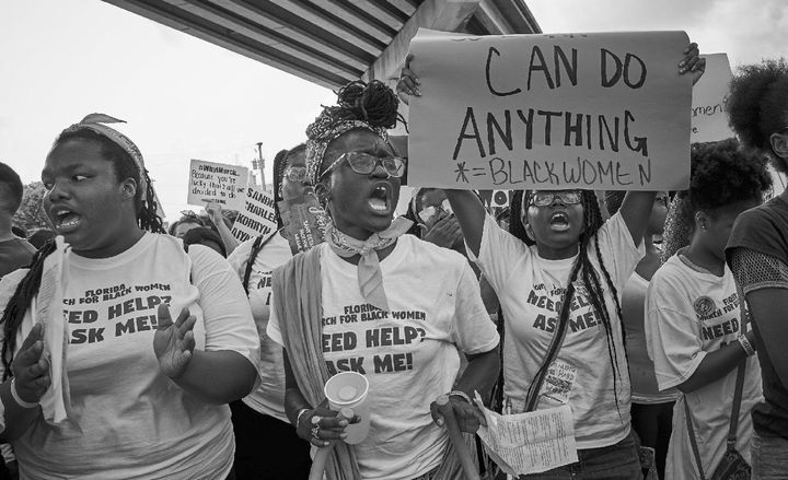 VictoriaByfield, Wakumi Douglas andAliyah Blackmon at the March for Black Women in Sept. 2017. Byfield and Blackm