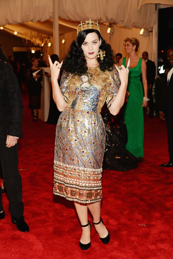"""Wearing <a href=""""https://www.wmagazine.com/gallery/katy-perry-met-gala-dresses/all"""" target=""""_blank"""">Dolce & Gabbana</a> a"""