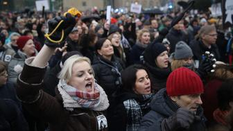 POZNAN, POLAND - MARCH 23:  People protesting against a new government measure to further restrict abortions in Poland gather as part of 'Black Friday' demonstrations nationwide on March 23, 2018 in Poznan, Poland. The governing PiS party is seeking to enact a law called 'Halt Abortion' that would make abortions based on congenital defects of the fetus illegal. Opponents, among them the women's rights group Dziewuchy Dziewuchom (Girls to Girls), called on women across Poland to go on strike today and gather for protests in cities nationwide. The conservative PiS party is pushing hard on policies based on a strongly Catholic-oriented political orientation and sought to make abortion completley illegal in 2016, though the attempt failed following large-scale protests. Poland currently allows abortion solely in cases of rape and irreparable damage to the fetus.  (Photo by Sean Gallup/Getty Images)