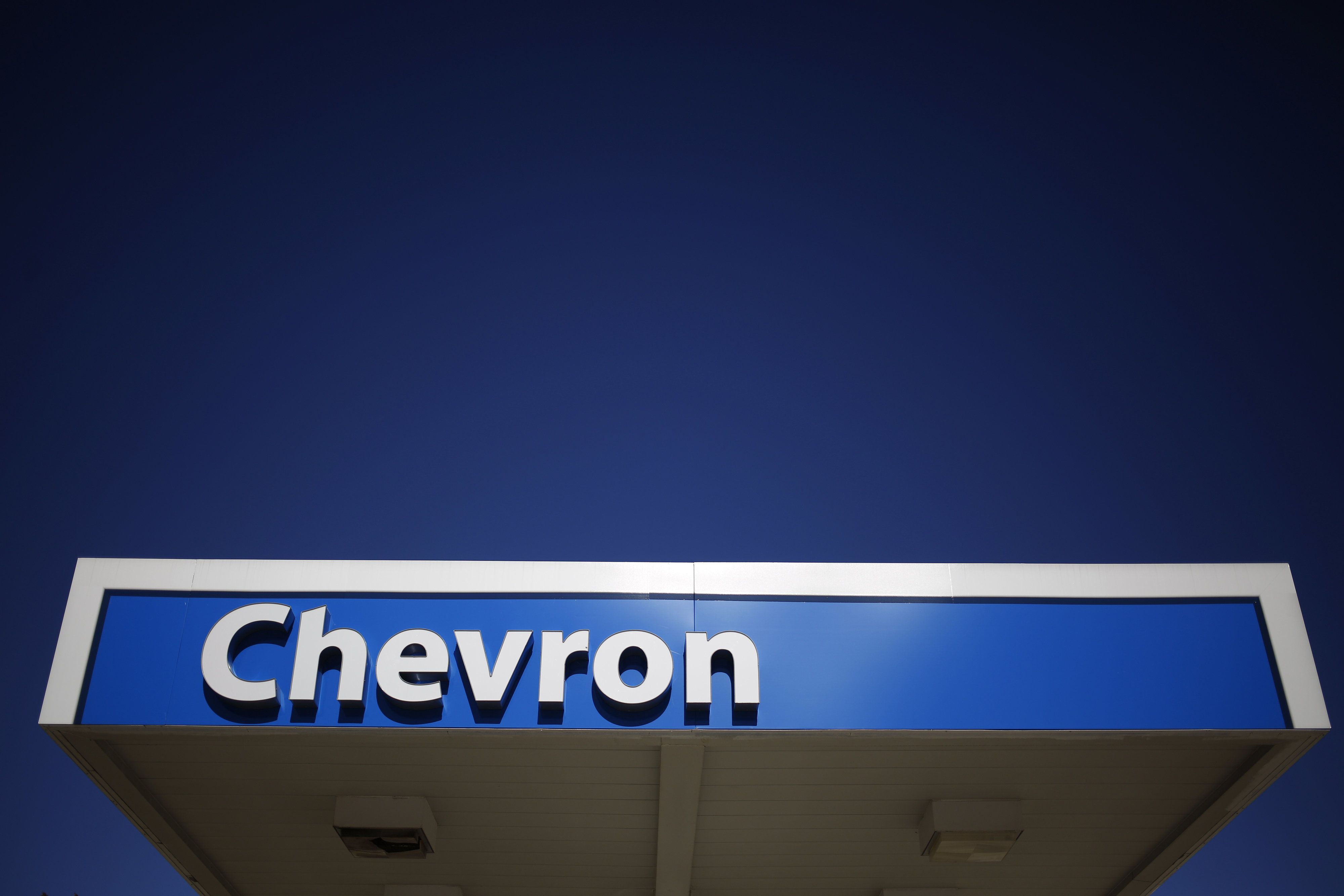 Signage is displayed at a Chevron Corp. gas station in Guild, Tennessee, U.S., on Tuesday, Jan. 24, 2017. Chevron Corp. is expected to release earnings figures on January 27. Photographer: Luke Sharrett/Bloomberg via Getty Images
