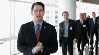 MILWAUKEE, WI - FEBRUARY 06: Wisconsin Governor Scott Walker arrives at an event held to announce Foxconn's plan to purchase an office building from Northwestern Mutual on February 6, 2018 in Milwaukee, Wisconsin. The building will be Foxconn's Wisconsin headquarters. Foxconn, which makes LCD screen panels, is building a $10 billion campus in Wisconsin.  (Photo by Scott Olson/Getty Images)