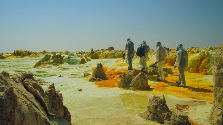 "In this shot from ""One Strange Rock,"" scientists walk through deadly acid pools near the Dallol volcano in Ethiopia.&nbs"