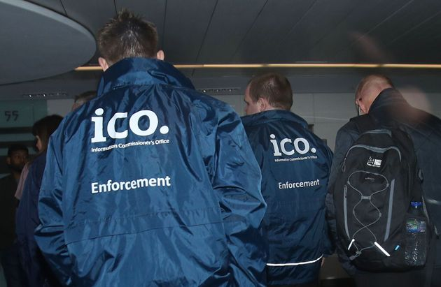 Enforcement officers working for the Information Commissioner's Office entering the offices of Cambridge...