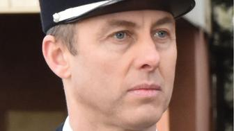 """This handout picture taken in Carcassone military headquarters in 2018 and released by the Gendarmerie Nationale on March 24, 2018 shows French Lieutenant Colonel Arnaud Beltrame who was killed after swapping himself for a hostage in a rampage and siege in the town of Trebes, southwestern France on March 23.  Beltrame, 45, was among a group of officers who rushed to the scene in Trebes, near Carcassone, on March 23 after a gunman who claimed allegiance to the Islamic State group, stormed a supermarket and fired at shoppers. Beltrame offered to take the place of a woman the gunman had taken hostage and was shot. He died on March 24 of his wounds, becoming the gunman's fourth victim. / AFP PHOTO / GENDARMERIE NATIONALE / HO / RESTRICTED TO EDITORIAL USE - MANDATORY CREDIT """"AFP PHOTO / GENDARMERIE NATIONALE"""" - NO MARKETING NO ADVERTISING CAMPAIGNS - DISTRIBUTED AS A SERVICE TO CLIENTS"""