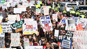 People arrive for the March For Our Lives rally against gun violence in Washington, DC on March 24, 2018. Galvanized by a massacre at a Florida high school, hundreds of thousands of Americans are expected to take to the streets in cities across the United States on Saturday in the biggest protest for gun control in a generation. / AFP PHOTO / Nicholas Kamm        (Photo credit should read NICHOLAS KAMM/AFP/Getty Images)