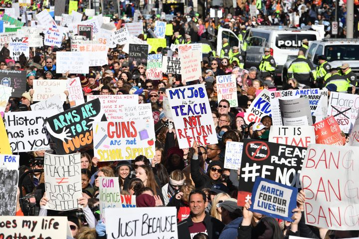 People arrive for the March for Our Lives rally against gun violence in Washington, D.C.