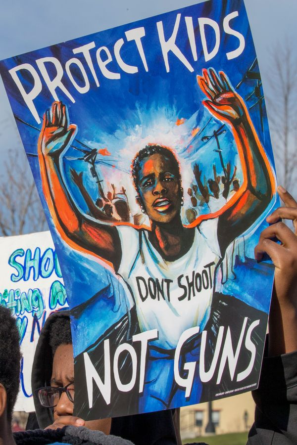 A student from Baltimore, Maryland, holds a protest sign during the rally inWashington.