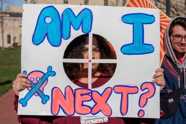 A student from Baltimore, Maryland, holds a protest sign during the March For Our Lives Rally in Washington.