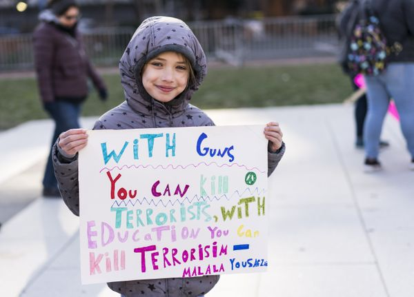 Emma Weill-Jones, 9, holds a sign featuring a quote from Malala Yousafzai at the March For Our Lives rally in Philadelphia.