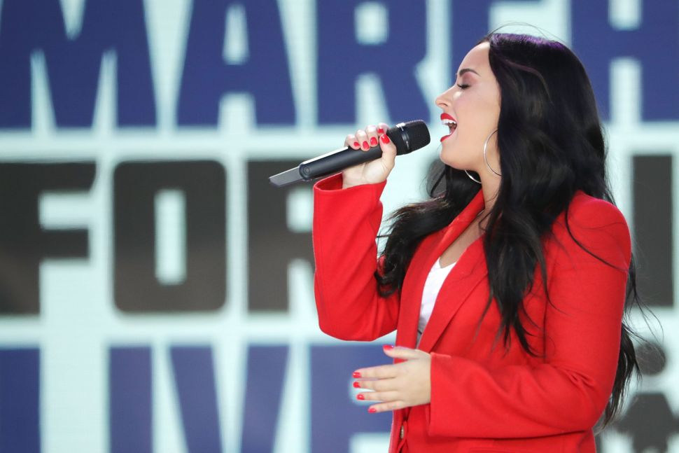 Demi Lovato performs 'Skyscraper' during the March for Our Lives.