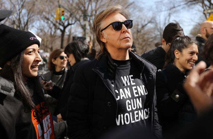 Paul McCartney joins thousands of people, many of them students, as they march against gun violence in Manhattan during the M