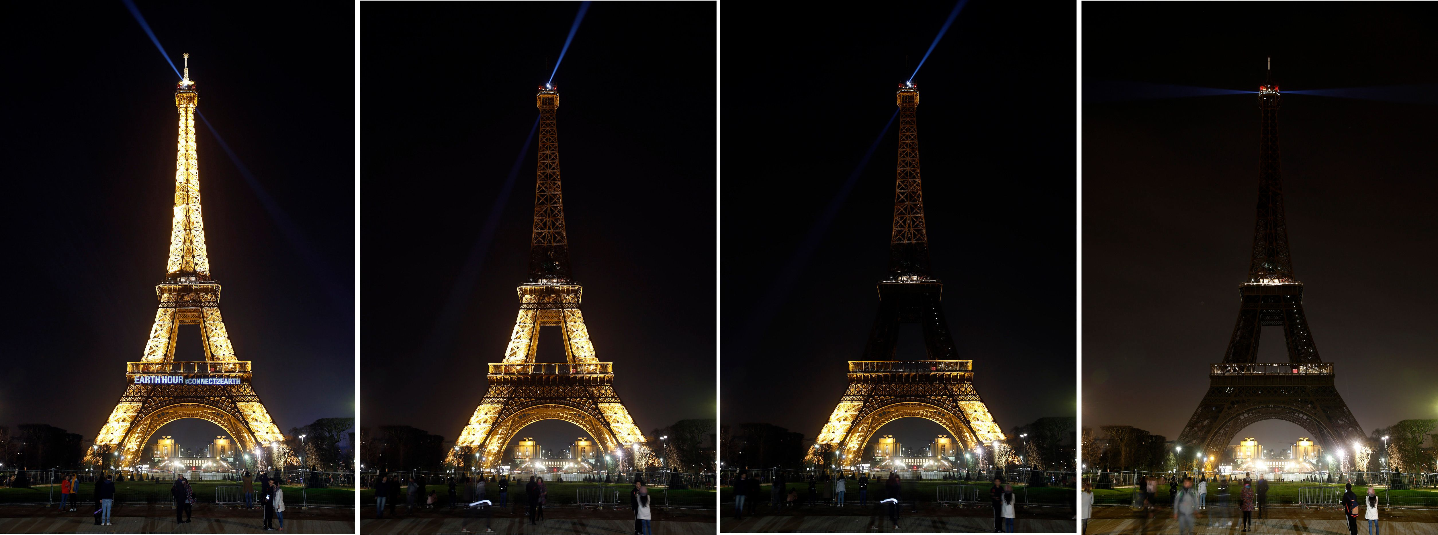 The Eiffel Tower is seen submerging into darkness as part of the Earth Hour switch-off on Saturday.