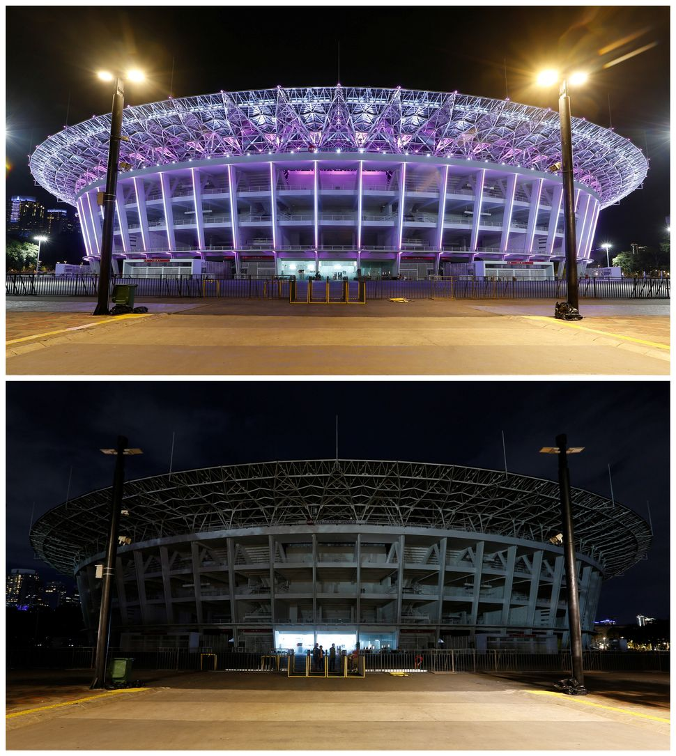 Gelora Bung Karno Stadium, before and after its lights were dimmed.