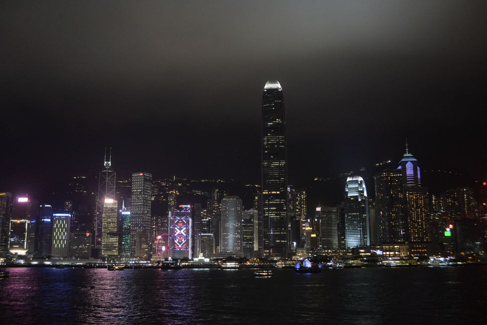 Buildings are lit up before Earth Hour along the Victoria Harbour in Hong Kong.