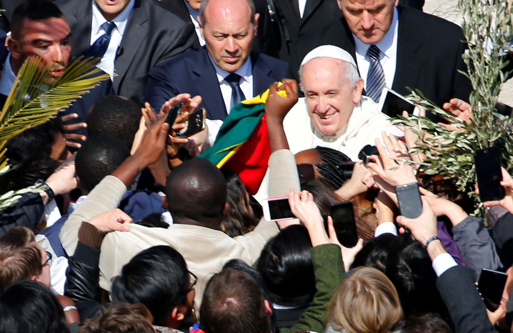 Pope Francis greets faithful after the Palm Sunday Mass in Saint Peter's Square at the Vatican, March 25, 2018.
