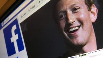 A picture taken in Moscow on March 22, 2018 shows an illustration picture of the English language version of Facebook about page featuring the face of founder and CEO Mark Zuckerberg. A public apology by Facebook chief Mark Zuckerberg, on March 22, 2018 failed to quell outrage over the hijacking of personal data from millions of people, as critics demanded the social media giant go much further to protect privacy. / AFP PHOTO / Mladen ANTONOV        (Photo credit should read MLADEN ANTONOV/AFP/Getty Images)