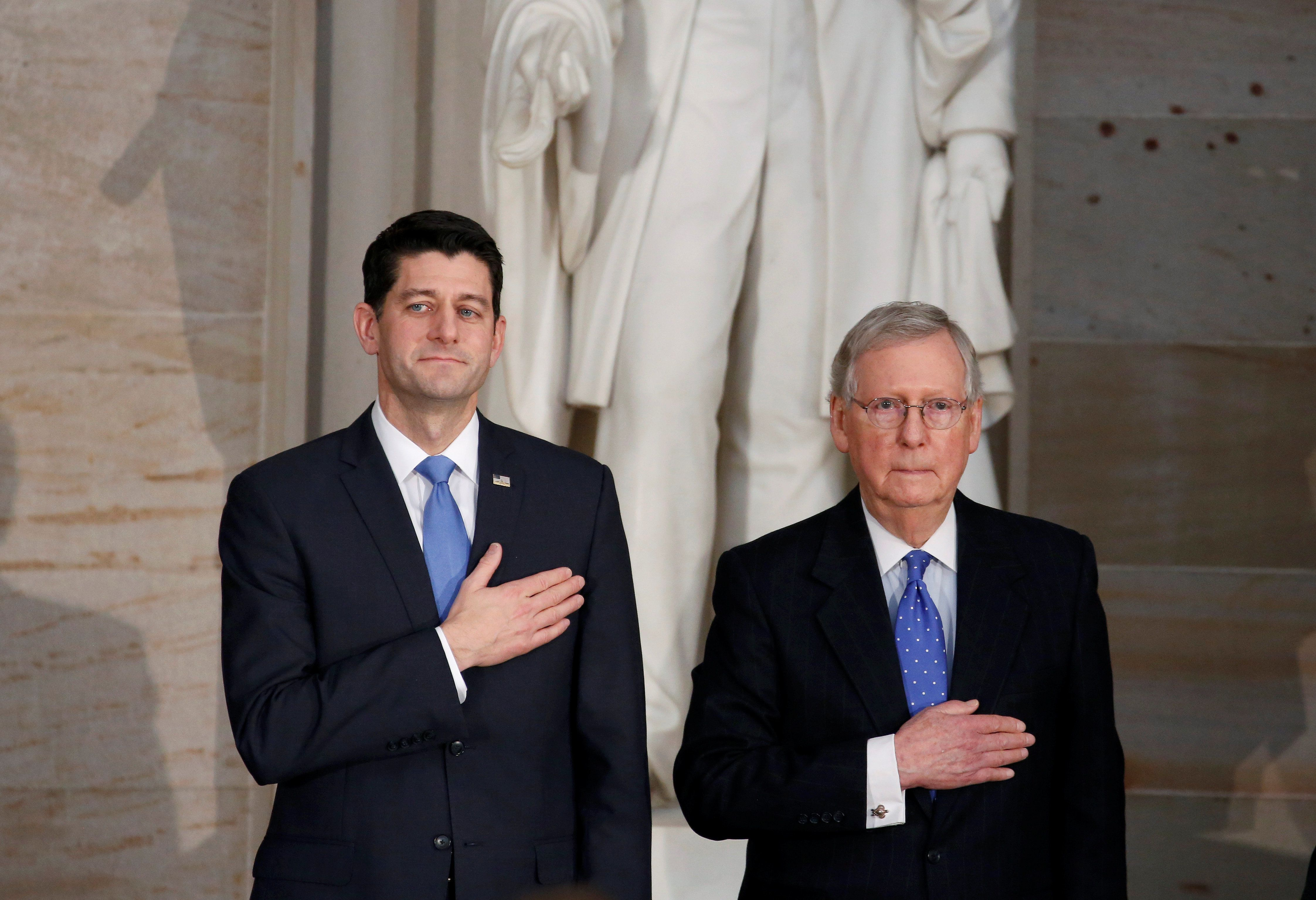 Speaker of the House Paul Ryan (R-WI) and Senate Majority Leader Mitch McConnell (R-KY) stand during a Congressional Gold Medal ceremony honoring former Senate majority leader Bob Dole (R-KS) on Capitol Hill in Washington, U.S., January 17, 2018.      REUTERS/Joshua Roberts