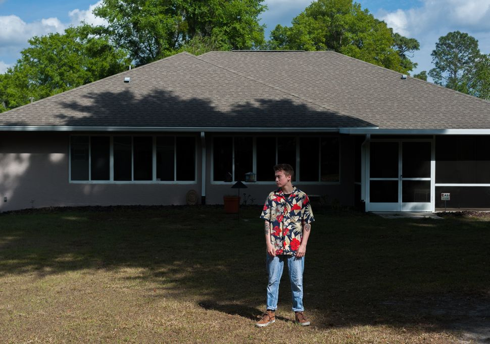 Preston Curts poses for a photo outside his home in Ocala, Florida.