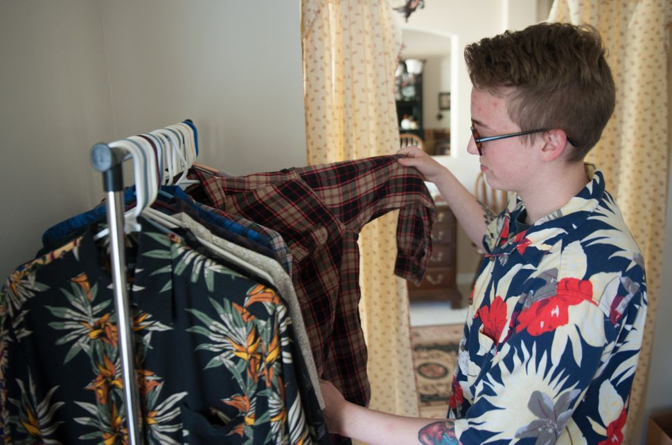 Preston Curts looks through clothes at his home in Ocala, Florida.